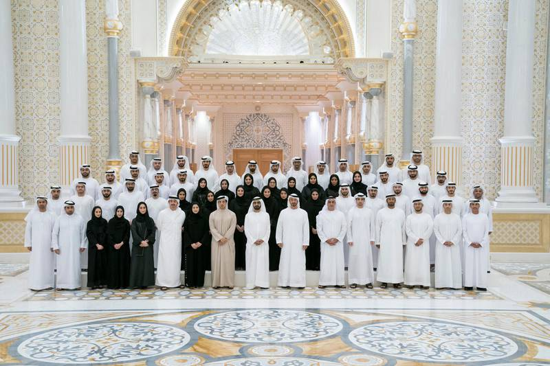 ABU DHABI, UNITED ARAB EMIRATES - January 05, 2020: HH Sheikh Mohamed bin Zayed Al Nahyan, Crown Prince of Abu Dhabi and Deputy Supreme Commander of the UAE Armed Forces (front row 7th R) and HH Sheikh Mohamed bin Rashid Al Maktoum, Vice-President, Prime Minister of the UAE, Ruler of Dubai and Minister of Defence (front row 8th R), stand for a photograph after signing a piece of the Hope Probe, which will be launched to Mars in July, at Qasr Al Watan. Seen with HE Dr Ahmed Abdullah Humaid Belhoul Al Falasi, UAE Minister of State for Higher Education (front row 2nd R), HH Lt General Sheikh Saif bin Zayed Al Nahyan, UAE Deputy Prime Minister and Minister of Interior (front row 6th R), HH Sheikh Mansour bin Zayed Al Nahyan, UAE Deputy Prime Minister and Minister of Presidential Affairs (front row 9th R), HE Sarah Yousif Al Amiri, UAE Minister of State for Advanced Sciences (front row 10th R) and HH Sheikh Abdullah bin Zayed Al Nahyan, UAE Minister of Foreign Affairs and International Cooperation (front row 11th R).  ( Hamad Al Kaabi / Ministry of Presidential Affairs ) ---