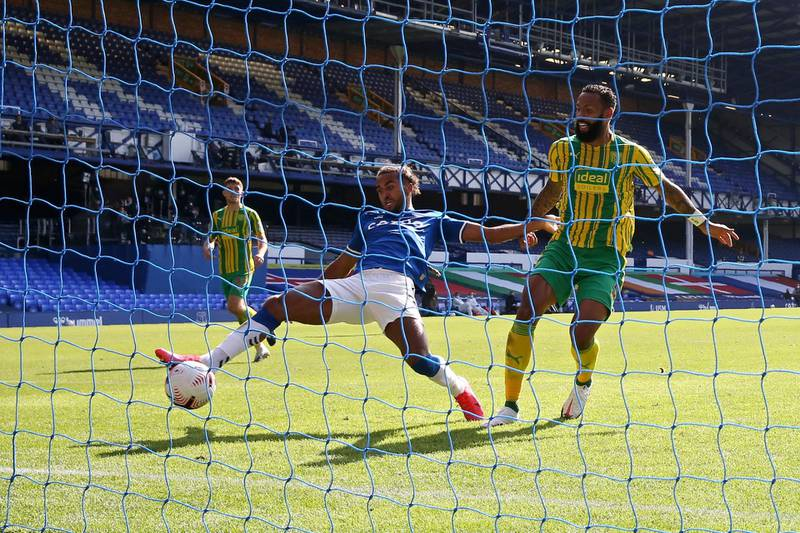 Everton's Dominic Calvert-Lewin scores his side's fourth goal during the English Premier League soccer match between Everton and West Bromwich Albion at Goodison Park in Liverpool, England Saturday, Sept. 19, 2020. (Alex Livesey/Pool via AP)