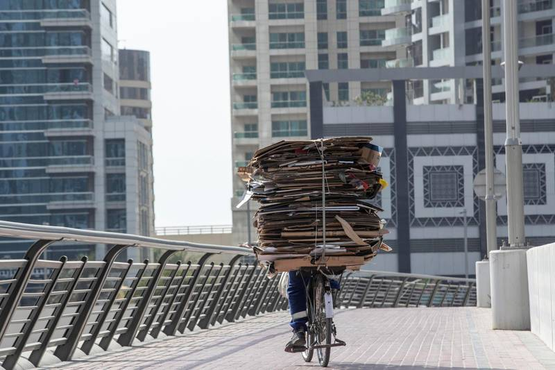 DUBAI, UNITED ARAB EMIRATES. 18 JULY 2020. Dubai Marina Walk now has new signs warning people not to go too fast on their bicycles or e-scooter along the promenade area. (Photo: Antonie Robertson/The National) Journalist: none. Section: National.