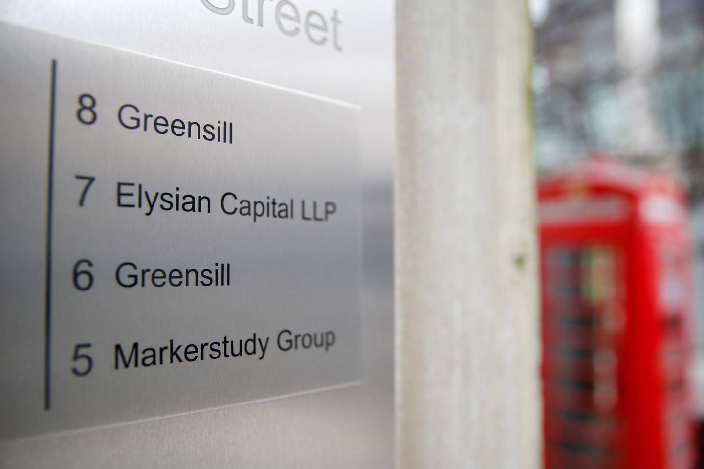 A sign at the building housing the headquarters of Greensill Capital in London, U.K., on Wednesday, March 3, 2021. Greensillis in the process of filing for insolvency in the U.K. after a swift crisis of confidence deprived it of major buyers of the loans it made and regulators stepped in to oversee its German bank. Photographer: Hollie Adams/Bloomberg