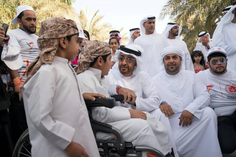 """ABU DHABI, UNITED ARAB EMIRATES - January 26, 2018: HH Sheikh Mohamed bin Zayed Al Nahyan, Crown Prince of Abu Dhabi and Deputy Supreme Commander of the UAE Armed Forces (3rd L) speaks with a participant during the in Special Olympics Wold Games Abu Dhabi 2019 initiative """"Walk Unified"""", at Umm Al Emarat Park. ( Mohamed Al Hammadi / Crown Prince Court - Abu Dhabi ) ---"""