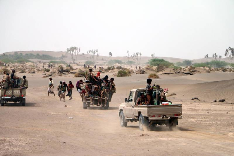 epa06847536 Yemeni government forces backed by the Saudi-led coalition take position during an attack on the port city of Hodeidah, on the outskirts of Hodeidah, Yemen, 27 June 2018 (Issued 28 June 2018). According to reports, Yemeni government forces backed by the Saudi-led coalition have made major gains south of Hodeidah during a military offensive to regain control of the Red Sea port-city that acts as an entrance point for Houthi rebel supplies and humanitarian aid.  EPA/NAJEEB ALMAHBOOBI