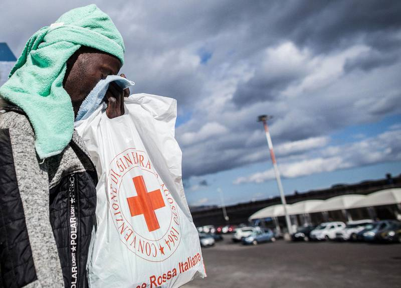 A migrant reacts as he disembarks from the Dutch-flagged Sea Watch 3 NGO rescue vessel after it docked on January 31, 2019 in the Sicilian port of Catania, southeastern Sicily.  A ship carrying 47 rescued migrants docked in the Sicilian port of Catania on January 31 with the crew fearing legal action as Italy's far-right interior minister tries to stop new arrivals. The ship which had been waiting off the coast of Sicily with people it rescued in the Mediterranean on January 19, was finally given permission to dock in Catania after six other countries agreed to take them in. / AFP / Federico Scoppa