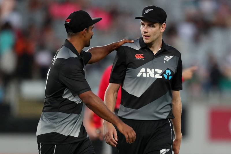 New Zealand's Ish Sodhi (L) and Jacob Duffy walk off the field after the first innings during the first T20 international cricket match between New Zealand and Pakistan at Eden Park in Auckland on December 18, 2020.  / AFP / MICHAEL BRADLEY