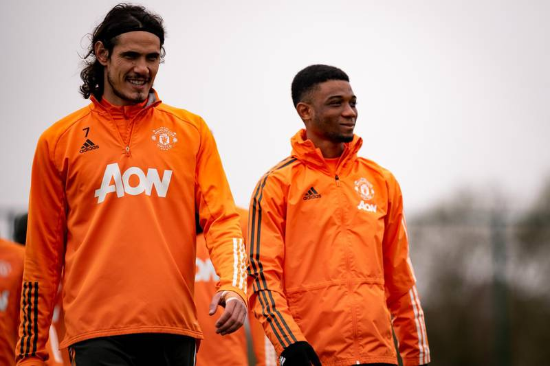 MANCHESTER, ENGLAND - MARCH 16: (EXCLUSIVE COVERAGE) Edinson Cavani and Amad of Manchester United in action during a first team training session at Aon Training Complex on March 16, 2021 in Manchester, England. (Photo by Ash Donelon/Manchester United via Getty Images)