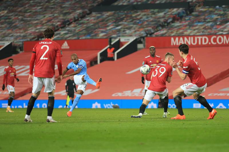 MANCHESTER, ENGLAND - JANUARY 06: Fernandinho of Man City shoots during the Carabao Cup Semi Final match between Manchester United and Manchester City at Old Trafford on January 6, 2021 in Manchester, England. (Photo by Simon Stacpoole/Offside/Offside via Getty Images)