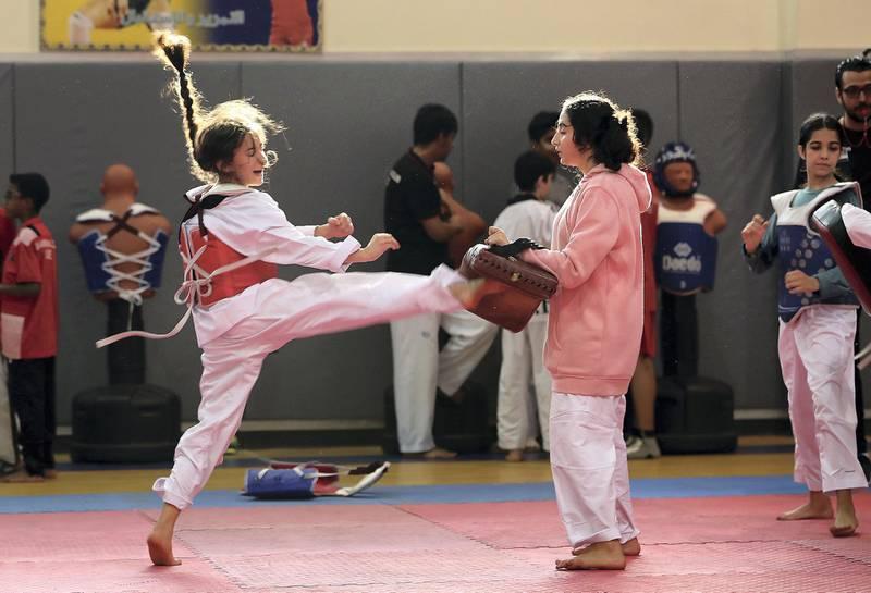 FUJAIRAH , UNITED ARAB EMIRATES , JUNE 04 – 2018 :- Students during the Taekwondo training class organised by Fujairah Martial Arts club held at Asem bin Thabit Secondary School for Boys in Fujariah.  ( Pawan Singh / The National )  For News. Story by Ruba Haza