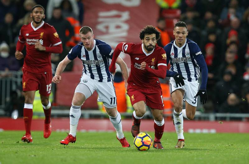 """Soccer Football - Premier League - Liverpool vs West Bromwich Albion - Anfield, Liverpool, Britain - December 13, 2017   Liverpool's Mohamed Salah in action with West Bromwich Albion's Chris Brunt and Kieran Gibbs    REUTERS/Andrew Yates    EDITORIAL USE ONLY. No use with unauthorized audio, video, data, fixture lists, club/league logos or """"live"""" services. Online in-match use limited to 75 images, no video emulation. No use in betting, games or single club/league/player publications.  Please contact your account representative for further details."""