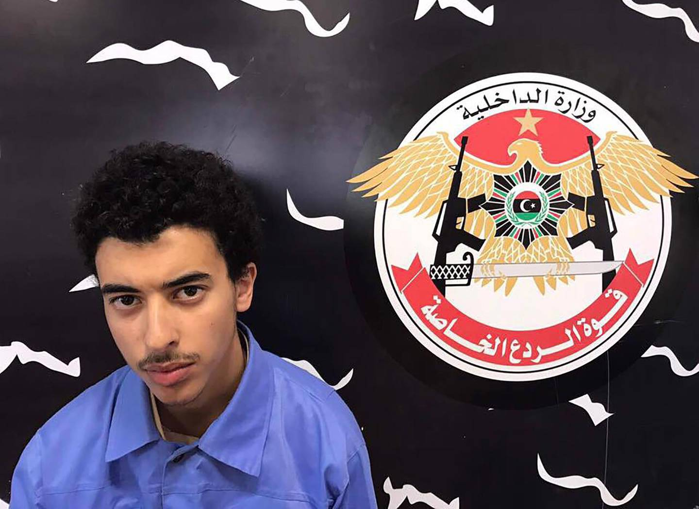 """(FILES) In this file photo taken on May 23, 2017 A photo released on the Facebook page of Libya's Ministry of Interior's Special Deterrence Force on May 24, 2017 claims to shows Hashem Abedi, the brother of the man suspected of carrying out the bombing in the British city of Manchester, after he was detained in Tripoli for alleged links to the Islamic State (IS) group. Hashem Abedi, brother of the Manchester bomber, was found guilty by an Old Bailey jury on March 17, 2020 of the murder of 22 people at an Ariana Grande concert. - RESTRICTED TO EDITORIAL USE - MANDATORY CREDIT """"AFP PHOTO / LIBYA'S SPECIAL DETERRENCE FORCE"""" - NO MARKETING NO ADVERTISING CAMPAIGNS - DISTRIBUTED AS A SERVICE TO CLIENTS    / AFP / LIBYA'S SPECIAL DETERRENCE FORCE / - / RESTRICTED TO EDITORIAL USE - MANDATORY CREDIT """"AFP PHOTO / LIBYA'S SPECIAL DETERRENCE FORCE"""" - NO MARKETING NO ADVERTISING CAMPAIGNS - DISTRIBUTED AS A SERVICE TO CLIENTS"""