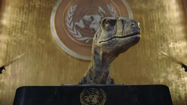 An image that illustrates this article Dinosaur storms into UN meeting - watch quirky climate change ad