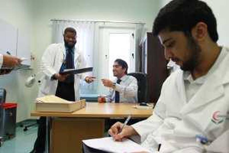 United Arab Emirates - Abu Dhabi - April 8th, 2010:  Dr Hassan Galadari, center, an emirati dermatologist, teaches a group of medical students at Tawam Hospital in Al AIn .  (Galen Clarke/The National)