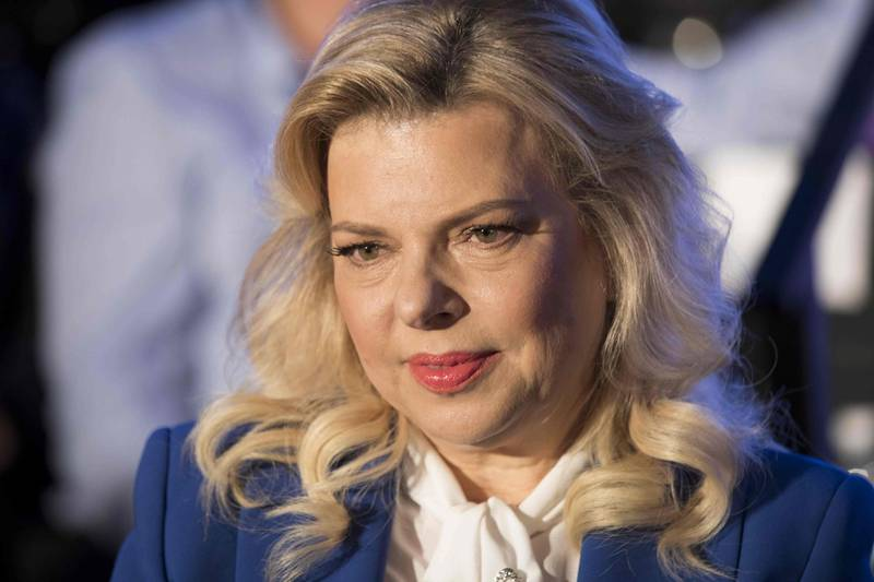 (FILES) In this file photo taken on May 21, 2017, Sara Netanyahu, the wife of the Israeli Prime Minister, attends a ceremony marking the 50th anniversary of the 1967 Israeli-Arab War, in the Old City of Jerusalem. Sara Netanyahu was charged with fraud and breach of trust on June 21, 2018 after a long police probe into allegations she falsified household expenses, the justice ministry said. / AFP / EPA POOL  / ABIR SULTAN