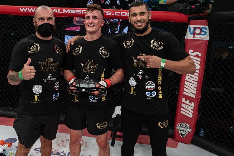 John Mitchell (centre) celebrates after his victory over Arbi Emiev in the UAE Warriors 20 at the Jiu-Jitsu Arena in Abu Dhabi on Saturday, June 19, 2021. Photo: UAE Warriors