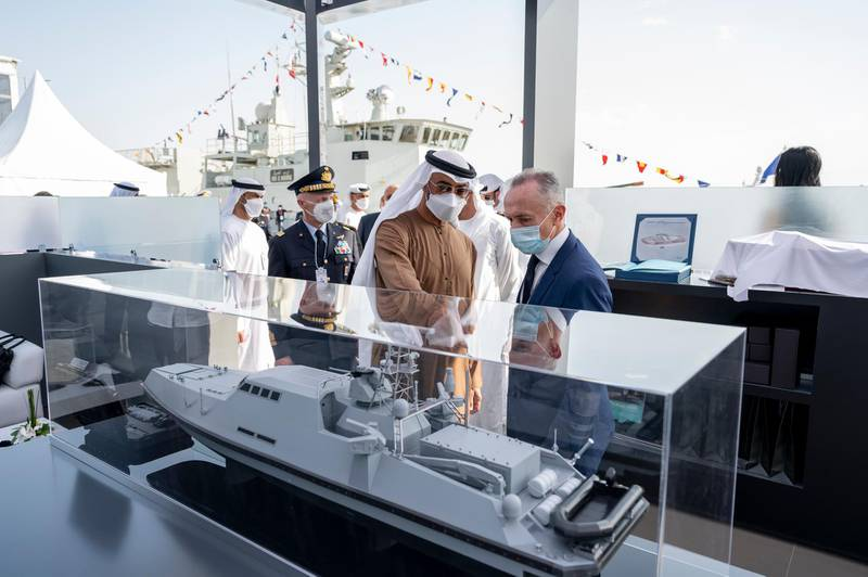 ABU DHABI, UNITED ARAB EMIRATES - February 23, 2021: HH Sheikh Mohamed bin Zayed Al Nahyan, Crown Prince of Abu Dhabi and Deputy Supreme Commander of the UAE Armed Forces (2nd R), tours the 2021 Naval Defence and Maritime Security Exhibition (NAVDEX), at ADNEC.   ( Hamad Al Kaabi / Ministry of Presidential Affairs ) ---