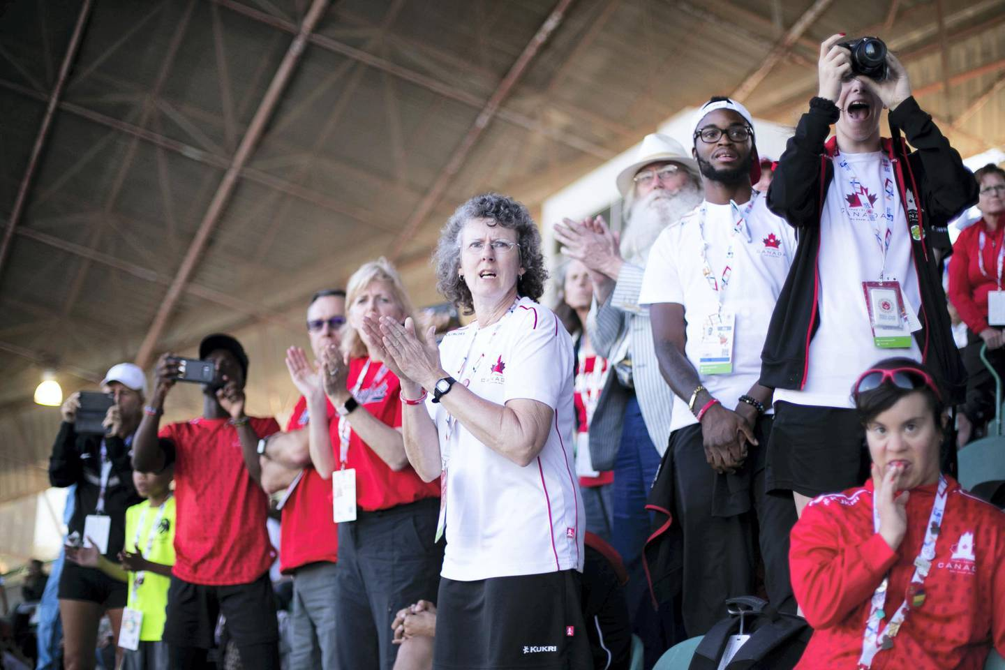 DUBAI, UNITED ARAB EMIRATES - March 19 2019.Audience members cheer on the athletes at Special Olympics World Games athletics 100M race in Dubai Police Academy Stadium. (Photo by Reem Mohammed/The National)Reporter: Section:  NA