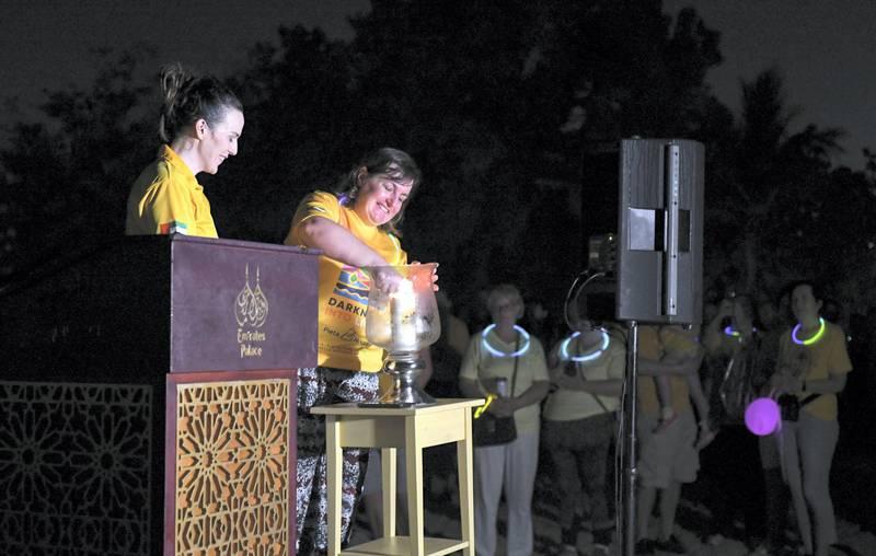 Abu Dhabi, United Arab Emirates - Caroline lights a candle before the walk begins at Emirates Palace. Khushnum Bhandari for The National