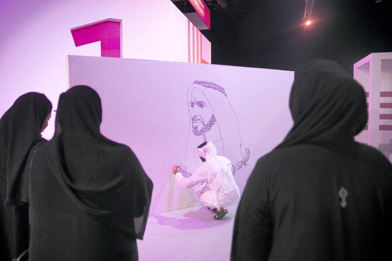 ABU DHABI, UNITED ARAB EMIRATES - OCTOBER 08, 2018.   An artist draws a caligraphic mural of Shaikh Zayed at  Mohammed Bin Zayed Council for Future Generations sessions, held at ADNEC.  (Photo by Reem Mohammed/The National)  Reporter: SHIREENA AL NUWAIS + ANAM RIZVI Section:  NA