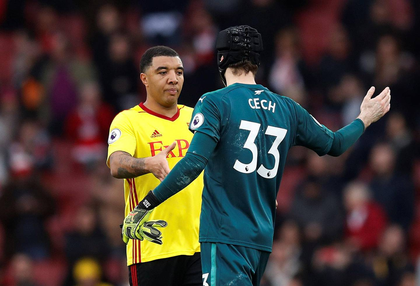 """Soccer Football - Premier League - Arsenal vs Watford - Emirates Stadium, London, Britain - March 11, 2018   Watford's Troy Deeney and Arsenal's Petr Cech at the end of the match   REUTERS/Eddie Keogh    EDITORIAL USE ONLY. No use with unauthorized audio, video, data, fixture lists, club/league logos or """"live"""" services. Online in-match use limited to 75 images, no video emulation. No use in betting, games or single club/league/player publications.  Please contact your account representative for further details."""