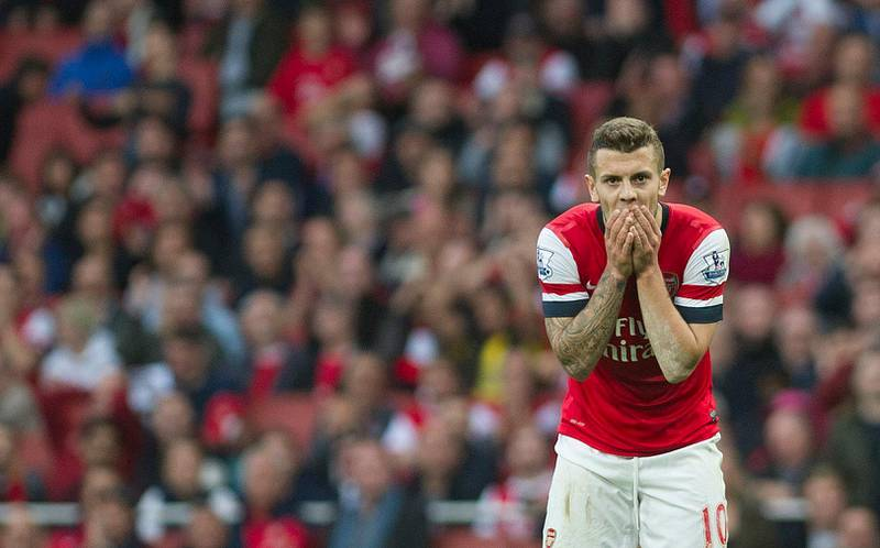 Arsenal's Jack Wilshere reacts after failing to score against Norwich City, during their English Premier League soccer match, at the Emirates Stadium, in London, Saturday, Oct. 19, 2013. (AP Photo/Bogdan Maran) *** Local Caption ***  Britain Soccer Premier League.JPEG-06d15.jpg