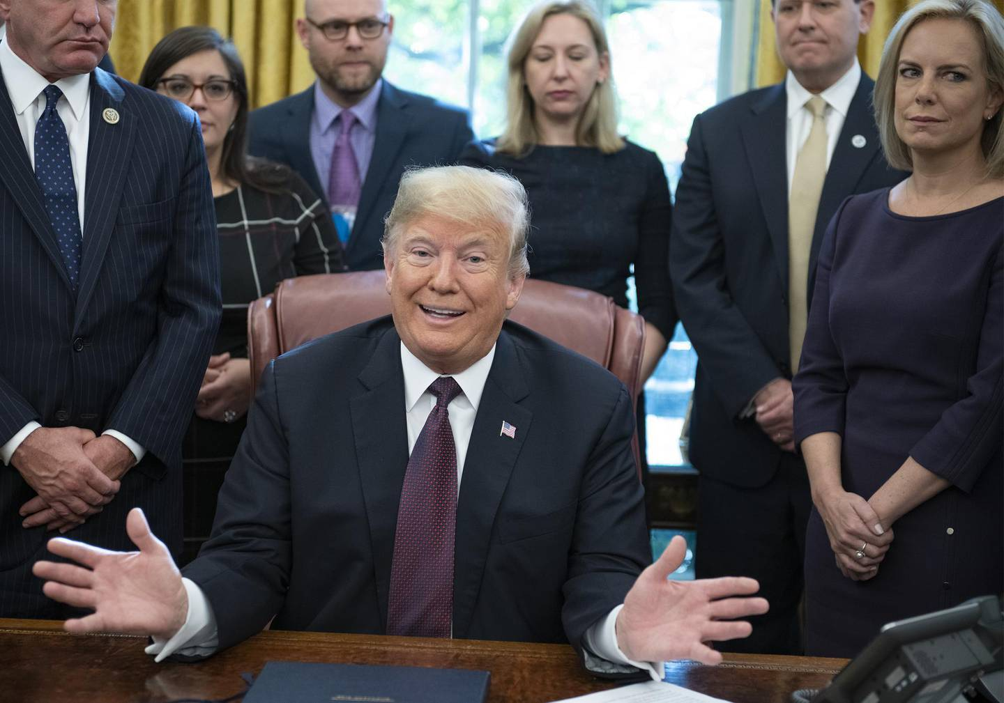 U.S. President Donald Trump speaks before signing the Cybersecurity and Infrastructure Security Agency Act in the Oval Office of the White House in Washington, D.C., U.S., on Friday, Nov. 16, 2018. Trumpsaid that he has just finished writing answers to questions from Special CounselRobert Muellerbut hasn't submitted them yet. Photographer: Ron Sachs/Pool via Bloomberg