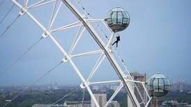 'James Bond' stuntman dangles from London Eye ahead of 'No Time to Die' premiere