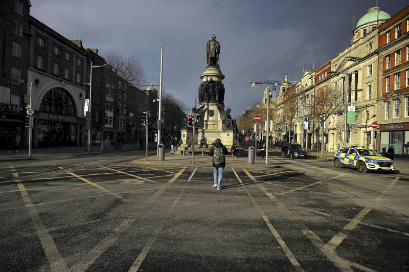 A Garda (Irish police) car is seen patrolling an empty O'Connell Street during the government's lockdown restrictions, amid the spread of the coronavirus disease (COVID-19) pandemic, in the city centre of Dublin, Ireland, January 23, 2021. REUTERS/Clodagh Kilcoyne