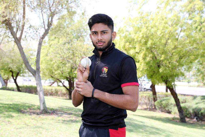 ABU DHABI, UNITED ARAB EMIRATES , March 26 – 2020 :- Yodhin Punja, the youngest cricketer to represent the UAE in both First Class and One Day Internationals. He is a student at Cardiff University but is back in Abu Dhabi for a break as the Universities in the UK are closed due to the spread of Coronavirus. He is at the Khaldia park near the corniche in Abu Dhabi. (Pawan Singh / The National) For Sports. Story by Amith