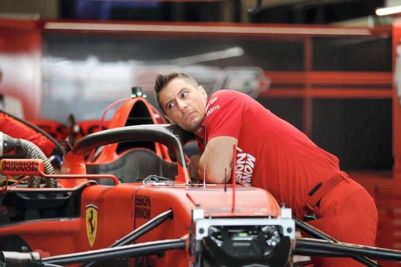 Abu Dhabi, United Arab Emirates, December 1, 2019.  Formula 1 Etihad Airways Abu Dhabi Grand Prix.--  VIP and drivers arrive at the Yas Marina Circuit.  A race engineer bussy tuning a Ferrari car.Victor Besa / The NationalSection:  SPReporter:  Simon Wilgress-Pipe