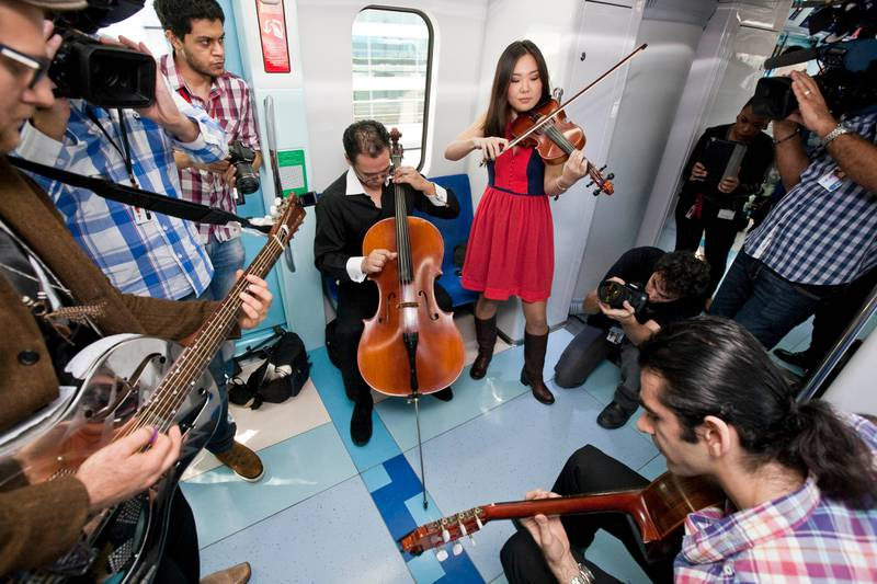 DUBAI, UNITED ARAB EMIRATES,  January 23, 2013. Tim Hassal (left with guitar) and Co perform during the Fashion Train show by Dubai Shopping Festival and Bloomingdales where a fashion show was held on the Dubai Metro. (ANTONIE ROBERTSON / The National)