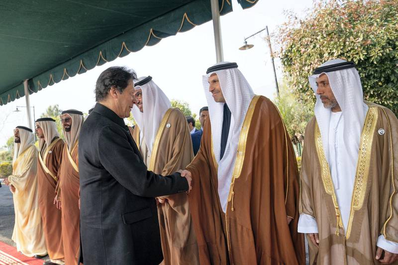 ISLAMABAD, PAKISTAN - January 06, 2019: HE Khaldoon Khalifa Al Mubarak, CEO and Managing Director Mubadala, Chairman of the Abu Dhabi Executive Affairs Authority and Abu Dhabi Executive Council Member (2nd R), greets HE Imran Khan, Prime Minister of Pakistan (L), at the Prime Minister's residence.   (  Mohammed Al Hammadi / Ministry of Presidential Affairs ) ---