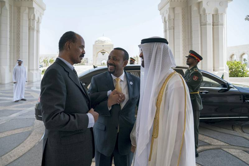 ABU DHABI, UNITED ARAB EMIRATES - July 24, 2018: HH Sheikh Mohamed bin Zayed Al Nahyan Crown Prince of Abu Dhabi Deputy Supreme Commander of the UAE Armed Forces (R), bids farewell to HE Dr Abiy Ahmed, Prime Minister of Ethiopia (C) and HE Isaias Afwerki, President of Eritrea (L), at the Presidential Palace.   ( Hamad Al Kaabi / Crown Prince Court - Abu Dhabi ) ---