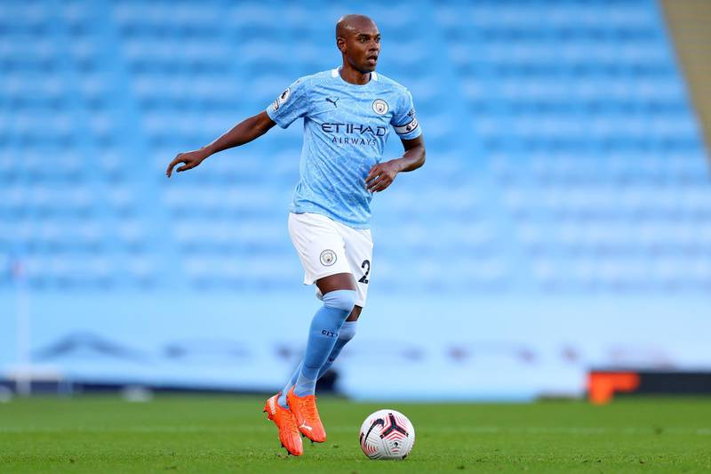 Manchester City's Brazilian midfielder Fernandinho runs with the ball during the English Premier League football match between Manchester City and Leicester City at the Etihad Stadium in Manchester, north west England, on September 27, 2020. (Photo by Catherine Ivill / POOL / AFP) / RESTRICTED TO EDITORIAL USE. No use with unauthorized audio, video, data, fixture lists, club/league logos or 'live' services. Online in-match use limited to 120 images. An additional 40 images may be used in extra time. No video emulation. Social media in-match use limited to 120 images. An additional 40 images may be used in extra time. No use in betting publications, games or single club/league/player publications. /
