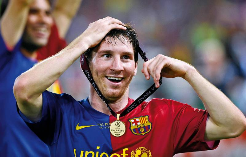 """Lionel Messi of Barcelona celebrates victory with his winner's medal round his head after his side beat Manchester United in the 2009 Champions League final at the Olympic Stadium on May 27th 2009 in Rome, Italy (Photo by Tom Jenkins/Getty Images). An image from the book """"In The Moment"""" published June 2012"""