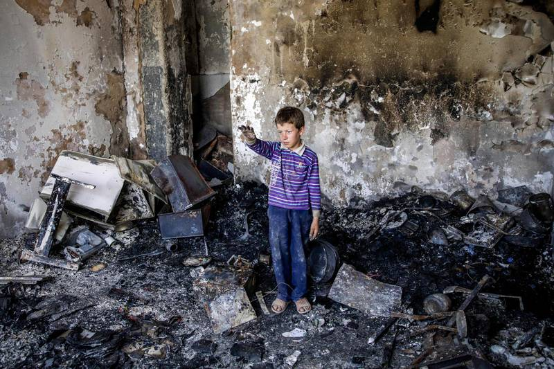 epa07747168 An Afghan child stands in his damaged room a day after a suicide attack followed by a gunfight against the office of Afghan former chief of intelligence and current candidate for first vice president of Ashraf Ghani, in Kabul, Afghanistan, 29 July 2019. According to reports, at least 20 people were killed and 50 others wounded in the incident which targeted the office of Amrullah Saleh.  EPA/HEDAYATULLAH AMID