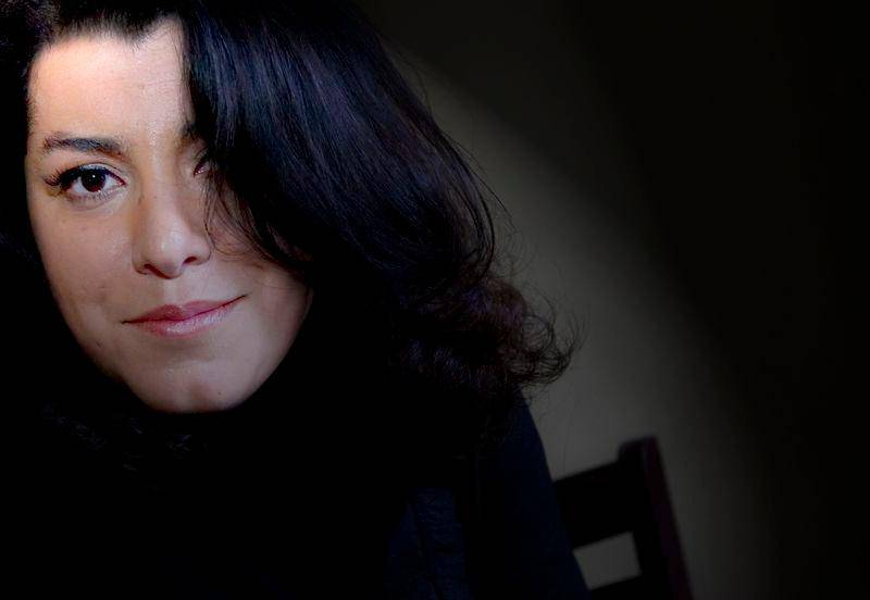 """Author and actress Marjane Satrapi sits for photographs Friday, Dec. 14, 2007 in New York.The movie """"Persepolis,"""" based on the novel of the same name, written by Satrapi, is a hand drawn animated work about a young girl in Iran during the Islamic revolution. (AP Photo/Stephen Chernin)"""