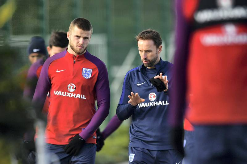 England's manager Gareth Southgate (2L) talks with England's midfielder Eric Dier (L) as they take part in an England national football team training session at Tottenham Hotspur FC Training Ground in Enfield, north London, on November 13, 2017 ahead of their international friendly match against Brazil on November 14.  / AFP PHOTO / Ben STANSALL / NOT FOR MARKETING OR ADVERTISING USE / RESTRICTED TO EDITORIAL USE
