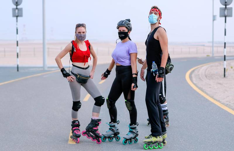 Abu Dhabi, United Arab Emirates, August 21, 2020.   The Madrollers skating group at the Al Wathba Bicycle Track do a  8 km. fun sprint.  The skating group has members from Dubai and Abu Dhabi.  They encourage safety and discipline on roller-skates, skateboard, long-board and bicycles. (L-R)  Lislotte, Rita and Chief strike a pose before the run.Victor Besa /The NationalSection:  Photo ProjectReporter:
