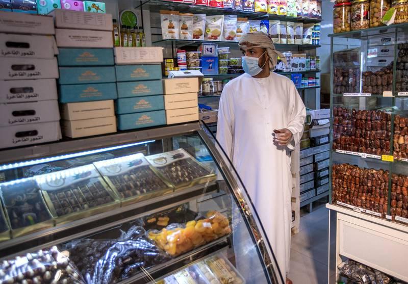 Abu Dhabi, United Arab Emirates, April 16, 2020.  A Ramadan date shopper at the Abu Dhabi Dates Marketat, Mina Zayed.Victor Besa / The NationalSection:  NAFor:  Standalone/Stock Images