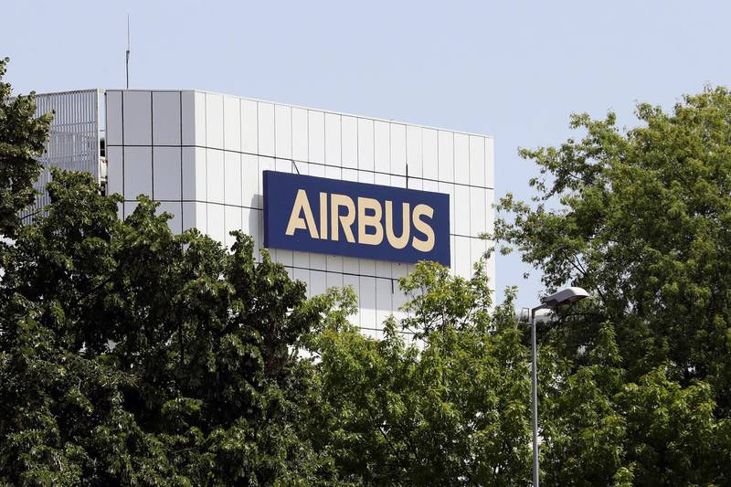 """FILE - In this Thursday, July 9, 2020 file photo, the logo of Airbus group is displayed in Toulouse, south of France. Struggling planemaker Airbus says new European virus lockdown measures are making its life """"a bit more difficult."""" It announced 1 billion euros ($1.16 billion) in COVID-related losses for the third quarter Thursday, Oct. 29, 2020 amid a slower-than-expected recovery in air travel. (AP Photo/Manuel Blondeau, file)"""