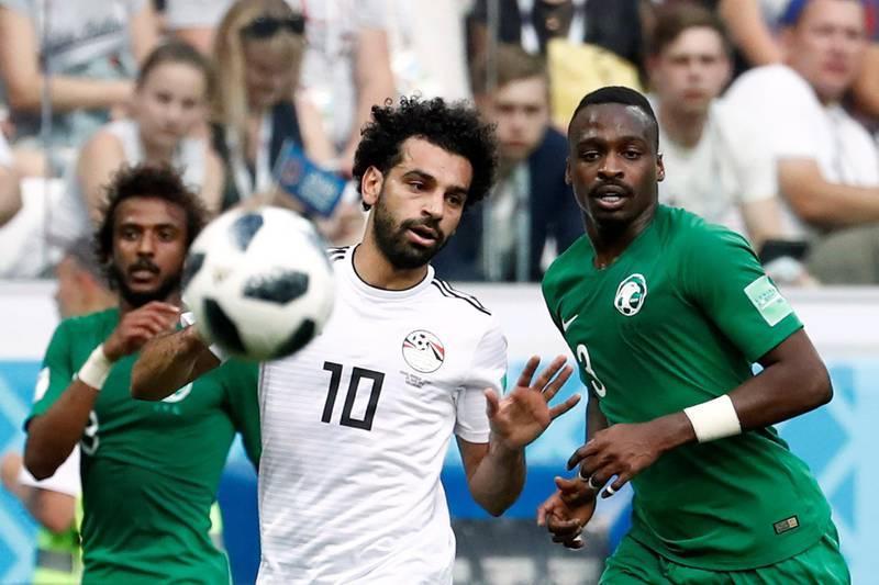 Soccer Football - World Cup - Group A - Saudi Arabia vs Egypt - Volgograd Arena, Volgograd, Russia - June 25, 2018   Egypt's Mohamed Salah in action with Saudi Arabia's Motaz Hawsawi    REUTERS/Damir Sagolj