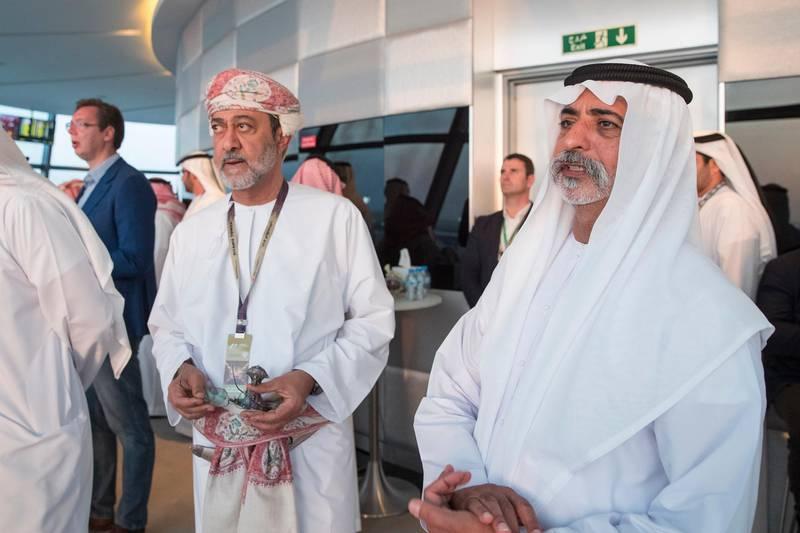 YAS ISLAND, ABU DHABI, UNITED ARAB EMIRATES - November 25, 2016: HH Sheikh Nahyan bin Mubarak Al Nahyan, UAE Minister of Culture and Knowledge Development (R) and HH Sayyid Haitham bin Tariq al Said, Minister of Heritage & Culture of Oman (L) attend the final day of Formula 1 Etihad Airways Abu Dhabi Grand Prix, in Shams Tower. ( Ryan Carter / Crown Prince Court - Abu Dhabi ) --- *** Local Caption ***  20161127RC_C164131.jpg