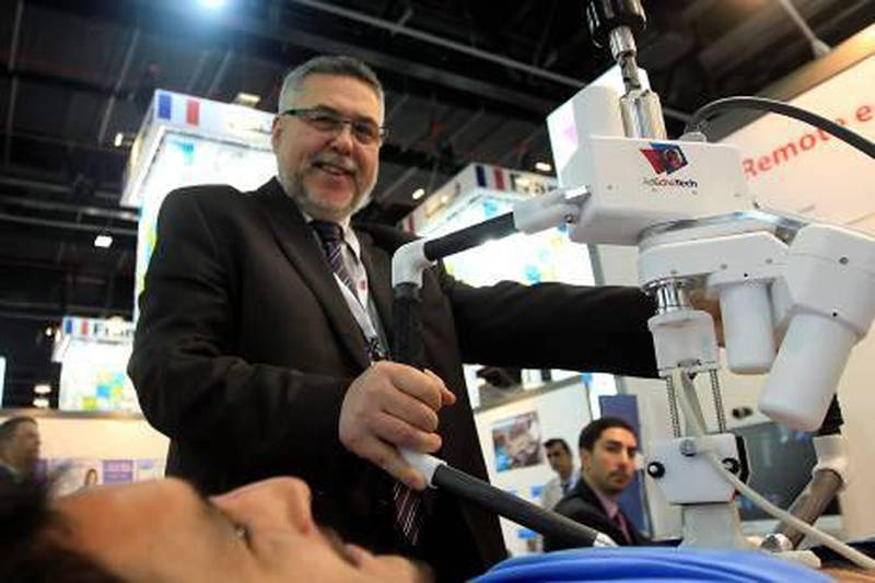 Dubai, United Arab Emirates- January, 29, 2013;  Dr Eric Lefebvre, CEO,  AdEchoTech demonstrates the new  Tele-Echography  during the Arab Health Exhibition  in Dubai . (  Satish Kumar / The National ) For Business
