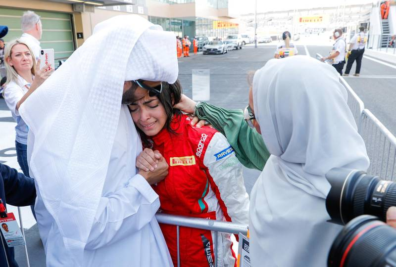 Abu Dhabi, United Arab Emirates, November 30, 2019.  Formula 1 Etihad Airways Abu Dhabi Grand Prix.-- FIA F4 Race 1.  Amna Al Qubaisi in tears of joy after taking the win as her father, Khaled and mother Kawter comfort her.Victor Besa / The NationalSection:  SPReporter:  Simon Wilgress-Pipe