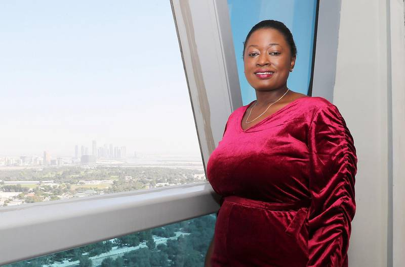 DUBAI, UNITED ARAB EMIRATES , December 16 – 2020 :- Sonia Olive Obaker Ngninkeu at her one bedroom apartment in the Damac Park Towers in Dubai. She rents out her apartment on Airbnb to earn side income. ( Pawan Singh / The National ) For News/Online. Story by Sarwat