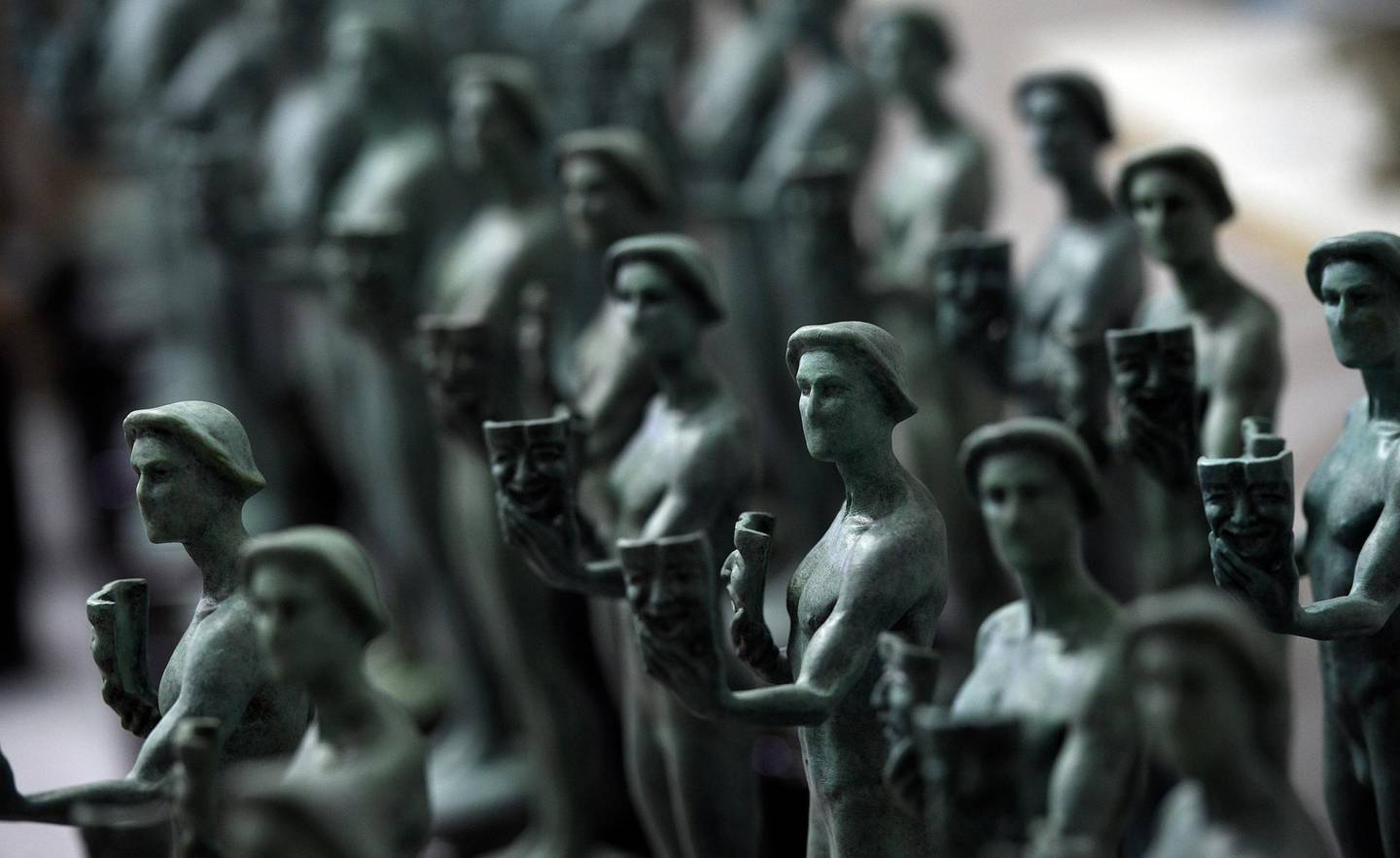 FILE - Finished Actor statuettes are displayed during the 25th annual Casting of the Screen Actors Guild Awards at American Fine Arts Foundry on Jan. 15, 2019, in Burbank, Calif. The SAG Awards announced Wednesday, Jan. 13, 2021, that the 27th annual ceremony has been moved to April 4. The awards had been originally scheduled to air March 14, but shifted to a different date to avoid conflict with the Grammys. (Photo by Chris Pizzello/Invision/AP, File)