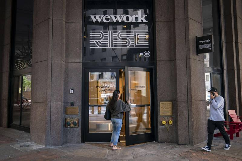 NEW YORK, NY - SEPTEMBER 13: A woman enters a WeWork office facility stands in the Financial District in New York City on September 13, 2019. WeWork has chosen to list their IPO on the Nasdaq with a September 23 trading debut. The company is now considering a valuation of potentially less than $20 billion after being previously valued on the private market for as much as $47 billion. The company has also reduced CEO Adam Neumann's voting power after receiving sharp criticism of their corporate governance.   Drew Angerer/Getty Images/AFP == FOR NEWSPAPERS, INTERNET, TELCOS & TELEVISION USE ONLY ==