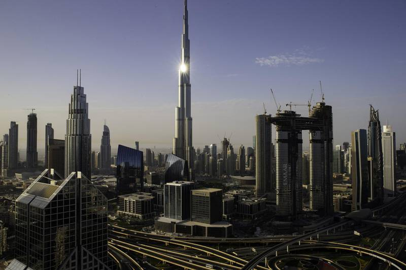 The Burj Khalifa tower, center, stands among city skyscrapers and the Address Sky View, right, under construction by developers Emaar Properties PJSC, in Dubai, United Arab Emirates, on Wednesday, April 11, 2018. Transformed into a flamboyant city state from an impoverished Gulf port in less than 50 years, Dubai defied geology to build skyscrapers and elaborately shaped islands in the sea. Photographer: Christopher Pike/Bloomberg