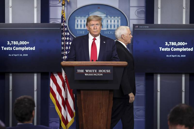 U.S. President Donald Trump, center, and Vice President Mike Pence, arrive to a news conference at the White House in Washington D.C., U.S. on Friday, April 17, 2020. Trump said there's enough coronavirus testing capacity to put in place his plan to allow a phased reopening of the economy, even though some state officials and business leaders have raised alarms about shortages. Photographer: Oliver Contreras/Sipa/Bloomberg