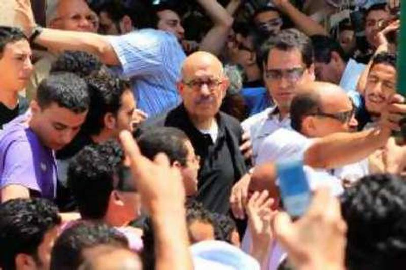 Egyptian Nobel Peace laureate and former UN atomic watchdog chief Mohamed ElBaradei attends a demonstration after Friday prayers in Alexandria June 25, 2010, against the death of Egyptian alleged victim of torture Khaled Said by the police earlier this month, in the port city of Alexandria. AFP PHOTO/KHALED DESOUKI *** Local Caption ***  868075-01-08.jpg