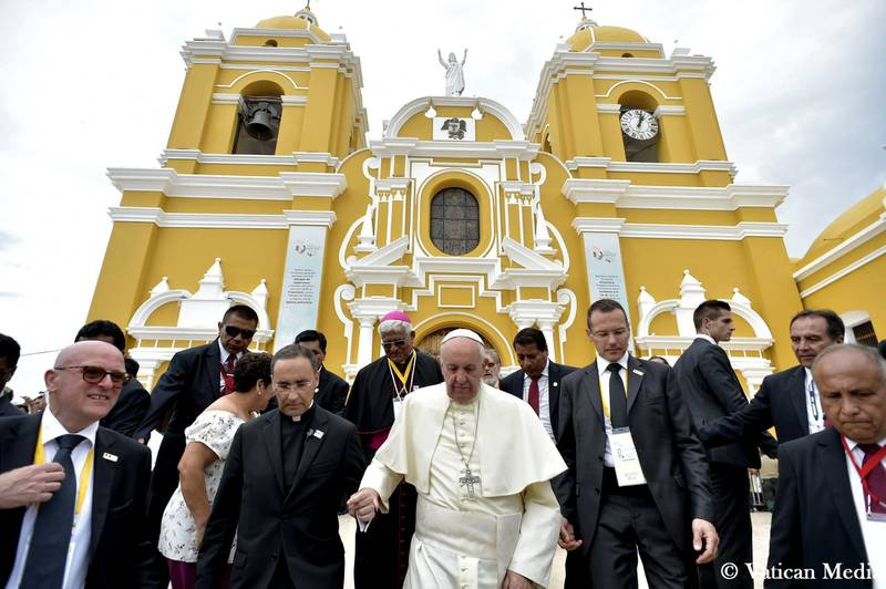 """Pope Francis leaves the Plaza de Armas Cathedral, in Trujillo, Peru, Saturday, Jan. 20, 2018. Francis consoled Peruvians who lost their homes and livelihoods in devastating floods last year, telling them Saturday they can overcome all of life's """"storms"""" by coming together as a community and stamping out the violence that plagues this part of the country. (L'Osservatore Romano/Pool Photo via AP)"""